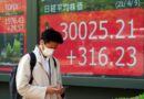 Asian shares mostly lower on strong China price data